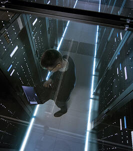 IronNet Man managing server room